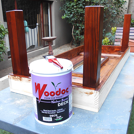 Follow the instructions on the container, applying three coats of woodoc water borne outdoor deck sealer  in total