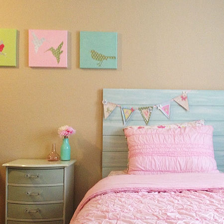 diy headboard with pine panels painted with blue paint