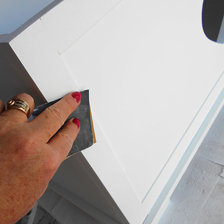 sand the painted furniture with 1000-grit sandpaper before applying sealer or wax