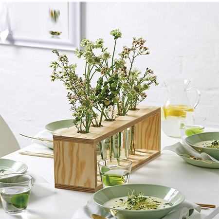 plywood flower stand with test tubes or plastic containers