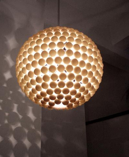 You can use any shape of lampshade or frame to make your own contemporary lighting with ping pong balls
