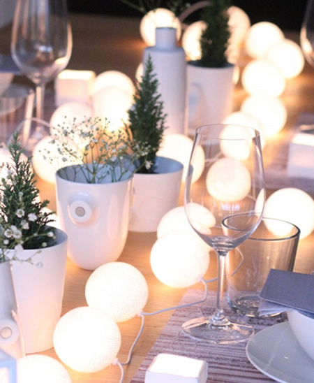 Ping pong balls are perfect for disguising LED string lights to create a wonderful, romantic table setting for a special occasion