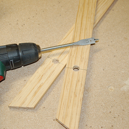 3. Use a 13mm spade bit to drill a hole at the top in all four legs. Place a wood offcut underneath where you are cutting for a neatly drilled hole on all sides.