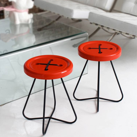 The button stools have a powder coated mild steel frame