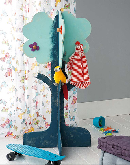 A wooden coat tree painted to match a bedroom