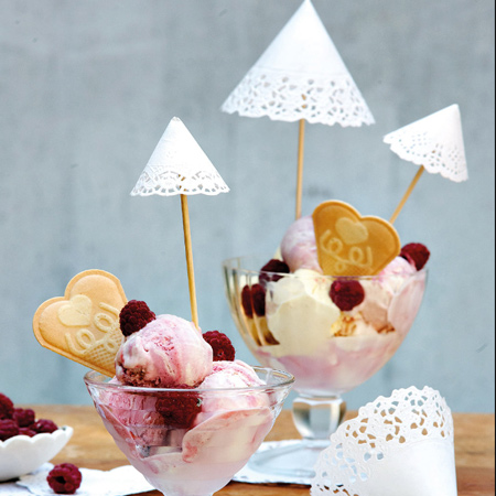 Oh so pretty desserts! Small paper doilies curled into cone shapes are hot-glued onto a cocktail stick or toothpick to make an elegant umbrella.