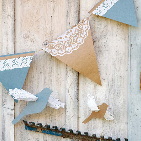 For a simple, decorative gardland cut out triangles to wrap over thin string and glue on a piece of lacy doily.  Browse the Internet for a bird template that you can cut out to add to your garland. Make a slit through the card to insert a folded doily for the wings and let your colourful garland take flight.