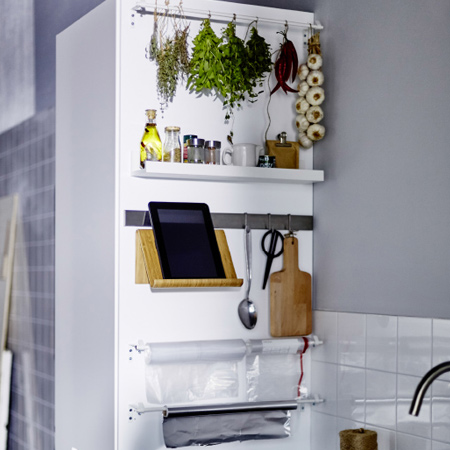 organise your kitchen suppliers with assorted rails and shelves. We made a shelf for spices and oil and a rail to hang tools like a tablet stand and scissors. The herbs, foil, and plastic bags are mounted on curtain rods.