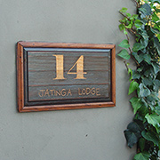 Garage door repurposed into house number