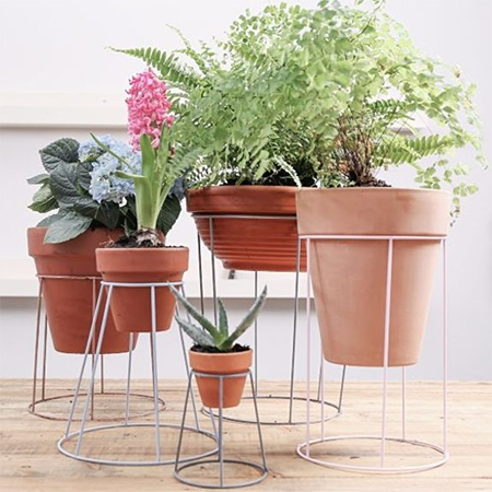 Upcycle old lampshades into plant stands
