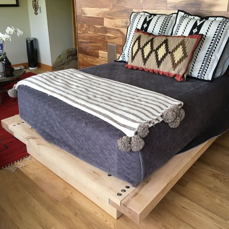 There are no measurements provided, but the size of frame and base is determined by the size of your mattress. In this way, you can use the method shown here to make a chunky platform bed to any size.