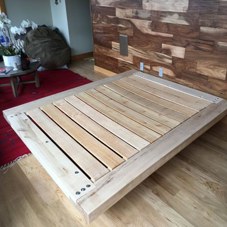 The finished base is mounted on 67mm x 67mm or 100mm x 100mm pine. You can use 2 of each stacked and glued together at the ends of the bed to increase the height