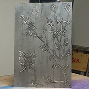 Faux pewter wall art