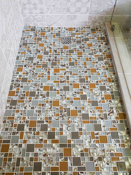 Mosaics installed in a shower are particularly popular. In this article TAL provides useful tips and guides on how to apply glass mosaics to a shower floor.
