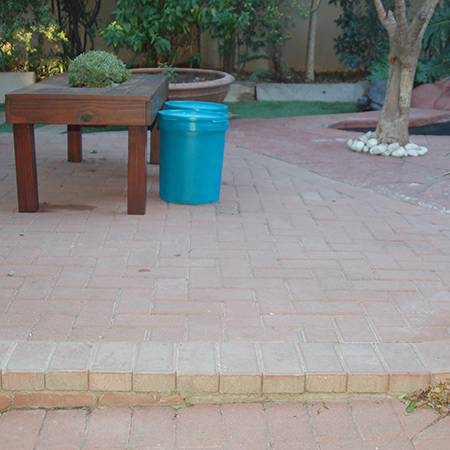 The cement paving bricks laid around the concrete pool surround are dull and do not add any appeal to the outdoor area. Painting the bricks will add an even colour over the bricks and concrete and allow for a quick washing down when the area needs to be cleaned