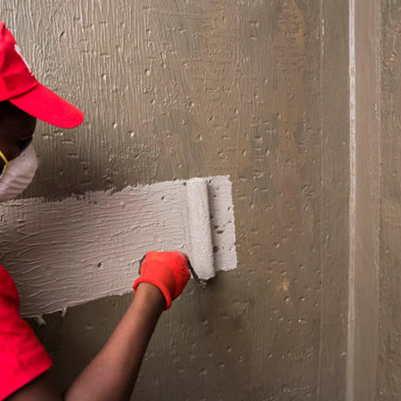 For the main shower wall and floor surfaces, apply the first coat of TAL Sureproof to the dry, primed surface with a short hair paint roller or brush, and allow approximately two hours to dry.