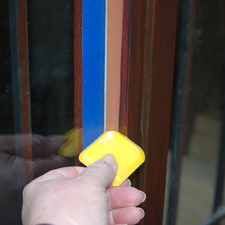 Use a profile to gently - and slowly - run over the top of the sealer to even out and push down into the gap between the glass and the frame. This gives a professional finishing touch to the finished edge.
