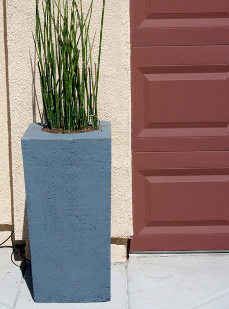 When shopping for concrete planters for my front entrance, I could not believe how expensive these are. Rather than spend a fortune, here's how to make your own concrete planters.
