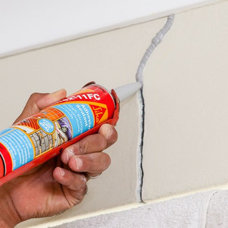 1. Scrape around the crack with a utility knife to remove any loose paint and debris. Use a vacuum cleaner and small dust nozzle to remove remaining dust and debris from the crack.