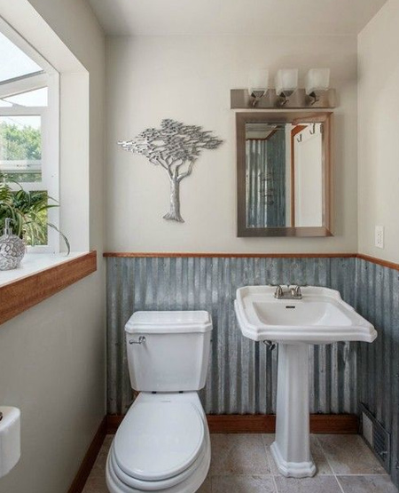 Not just bathrooms, you can make use of corrugated sheet metal to clad or decorate specific areas in a kitchen, or other rooms in a home.