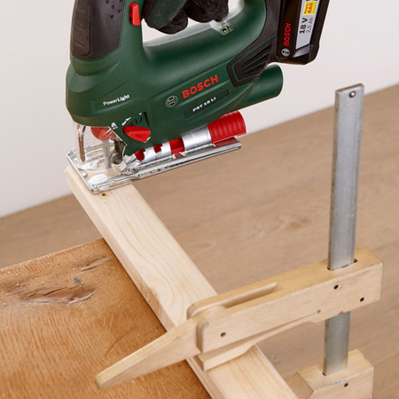 4. If not already done, cut the pine strips to length to fit at the top of the assembly.