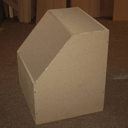 2. Assemble the box oven by securing the sides to the back and front. Place and secure the top and then attach the base.
