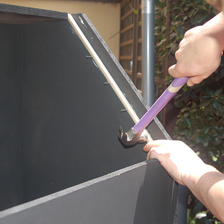 4. In this image you can see how the slots in the top allow for fitting the quarter-round rail down the sides. Attached with adhesive and panel pins. Both rails are cut at a 45-degree angle.