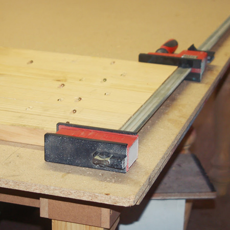 bessey clamps hold top planks together until glue dries