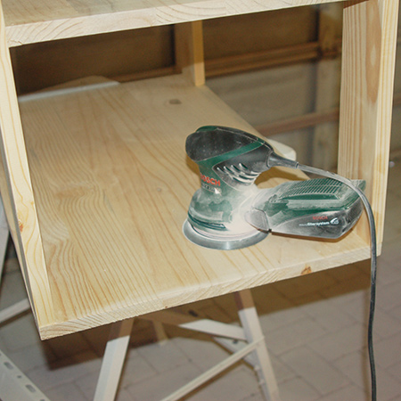 Mobile kitchen island being sanded