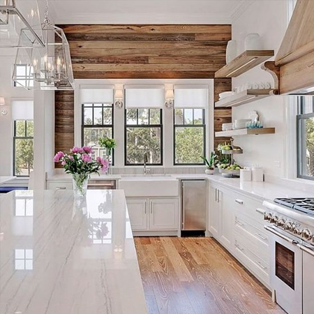 Sometimes less it best. Rather than overwhelm a white kitchen with reclaimed wood accessories, look at how you can incorporate a few wood touches here and there