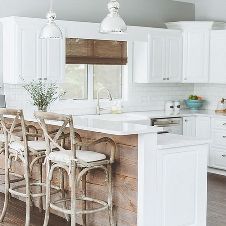 Reclaimed wood planks are mounted on a kitchen island