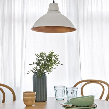 Give a pendant shade an instant update by spraying inside the shade with gold or copper spray paint