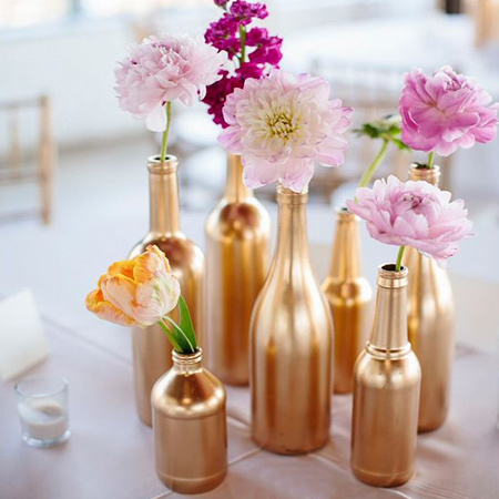 Recycle glass or plastic bottles into a wonderful centrepiece for a special occasion using Rust-Oleum Metallic or Universal spray paint