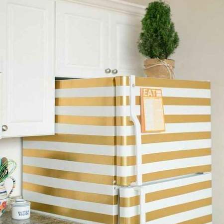 Refresh a refrigerator with gold stripes. Clean the surface with sugar soap, rinse and dry ad then use masking tape to mask off areas not being painted