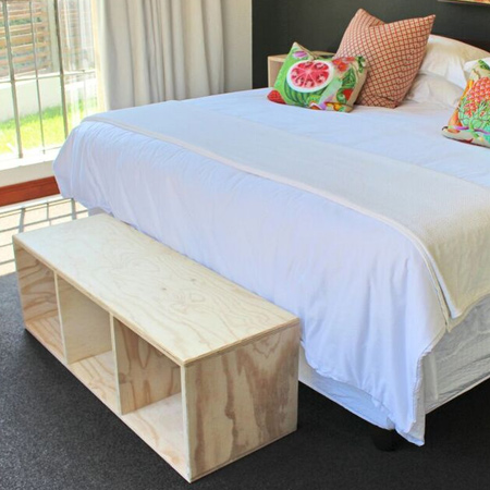 plywood bench at end of bed