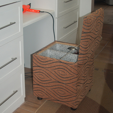upholstered storage ottoman for hair drying tools and accessories