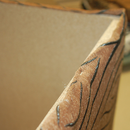 Upholstered ottoman staple fabric
