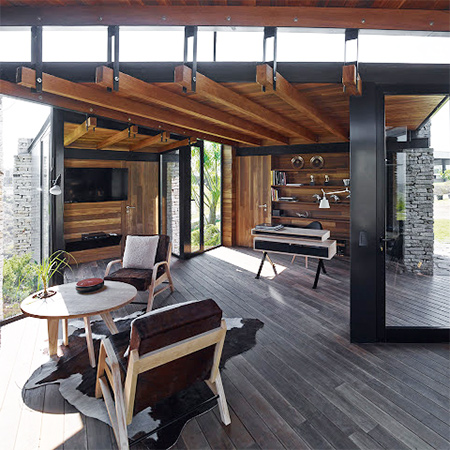 timber wood home has timber roof beams and wood floor