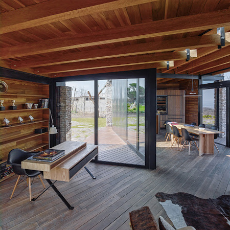 timber wood home has timber roof beams and wood floors