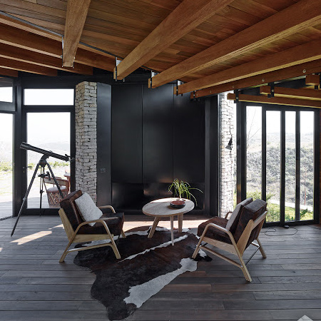 timber wood home with timber roof beams and wood floors