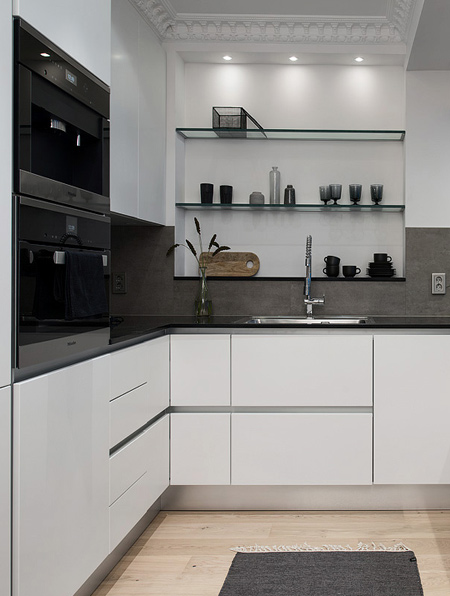 Replace old appliances with modern, reflective-finish appliances. Or add painted glass detailing for a modern touch