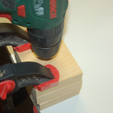 Secure the plug cutter in the end of your drill / driver and, on full power, mark the top of the wood for the plugs to a depth of about 5mm. Note: If your template block is thinner than ours you might be able to cut out the entire plug.