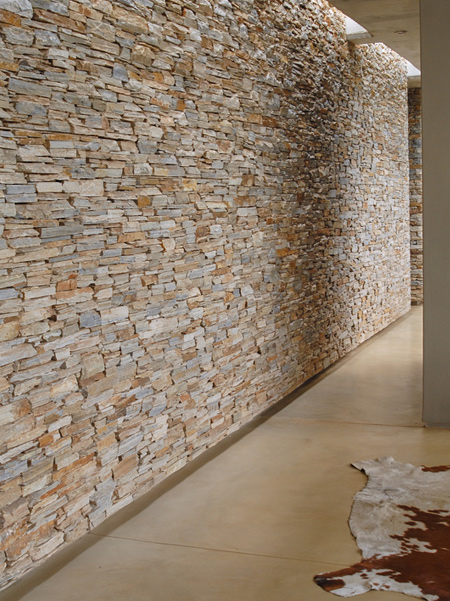 Planning of the home structured around a series of large mass dry-packed stone walls, treated as if almost already pre-existing on the site