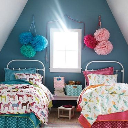 Colourful childrens or kids bedrooms with prominent paints