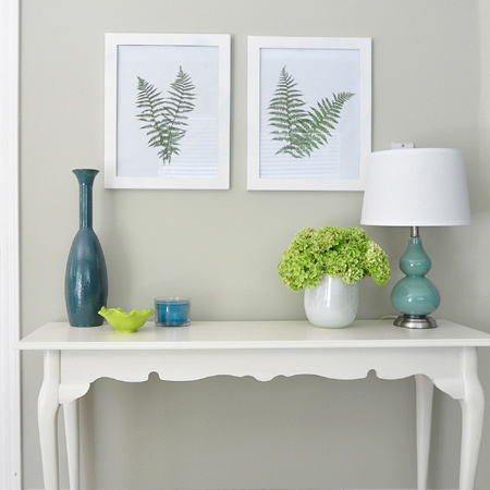 Bring a dash of nature indoors with a few fern fronds and inexpensive frames and add a unique feature to a plain wall.