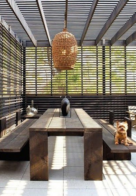 If space allows, a large shade umbrella can be incorporated into the design. Or you can look at building a simple pergola with slatted roof that provides a small amount of shade.