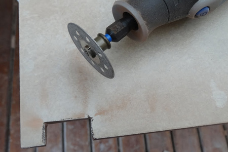 With the diamond cutting wheel you can cut curves or difficult shapes using your Dremel MultiTool. However, for cutting tiles invest in one of the higher speed models, such as the 8100, 8200 or Dremel 4000.
