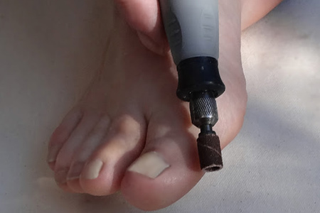 And last, but not least, use the Flexi Shaft and small 120-grit sanding ring to give your feet a pedicure.