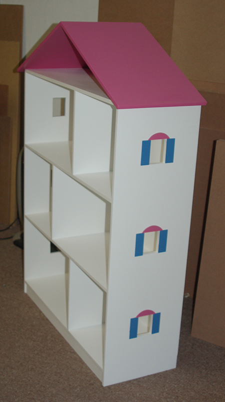 The main cabinet was painted in white and the roof in a pink colour. The window frames are painted in a matching pink, with the sides in Rust-Oleum 2X spray paint in satin Wildflower Blue. Once sprayed, the window frames were attached with Pattex No More Nails adhesive.