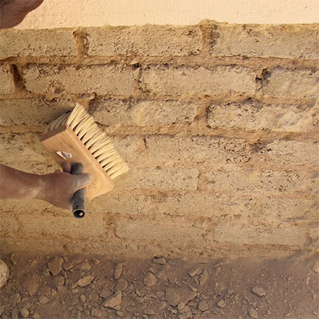 3. Use a 20mm masonry bit to drill holes two-thirds of the depth of the brick, into each brick immediately above the faulty damp proof-course. Use a brush to clean thoroughly, ensuring that no dust remains before moving on to the next step.